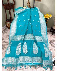 Banarasi Pure Khaddi Chiffon Silk with Silver Zari Work in Firoza